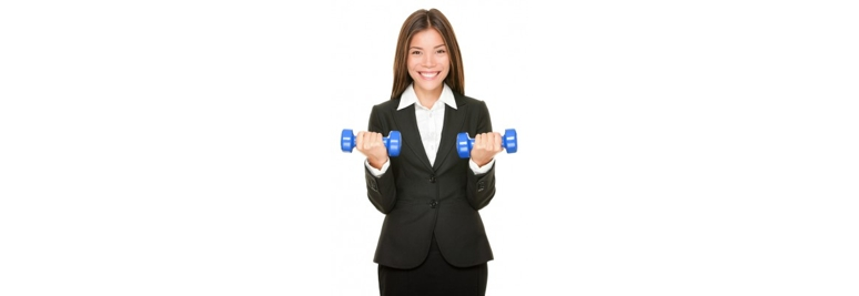 Business woman in suit lifting dumbbell weights